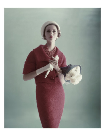 karen-radkai-vogue-february-1959-woman-with-bouquet-of-carnations
